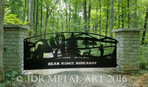 Drive gate with three bears in the design.