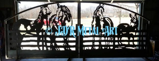 Decorative driveway gate with metal silhouette of four horses at fence.