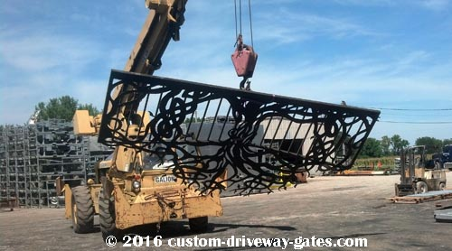 driveway-gate-being-lifted-with-crane