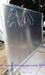 Plasma cutting aluminum driveway gates with horse design.