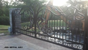 Driveway gates with wrought iron theme for Pennsylvania farm residence.
