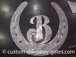 Aluminum horseshoe design cut with plasma cutter by JDR Metal Art.