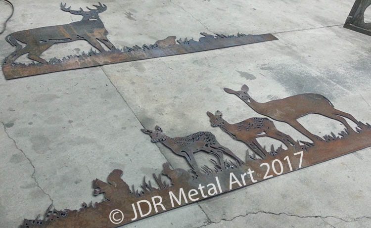 "Plasma cut deer scene on 3/16"" thick steel sheet."