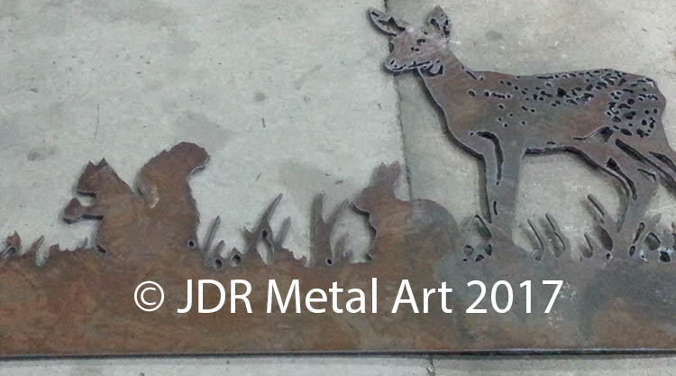 Plasma cut fawn rabbit and squirrel.