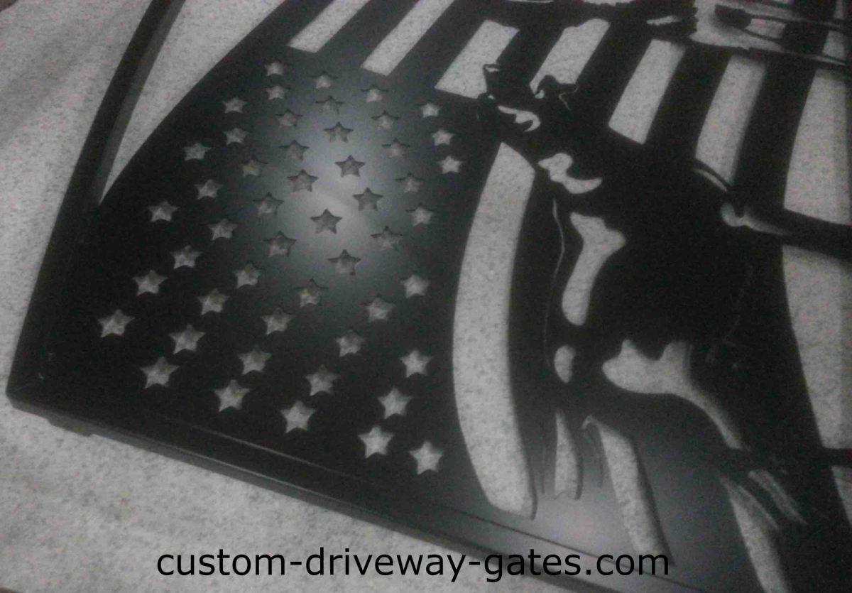 Steel single swing ornamental driveway gate with plasma cut design.