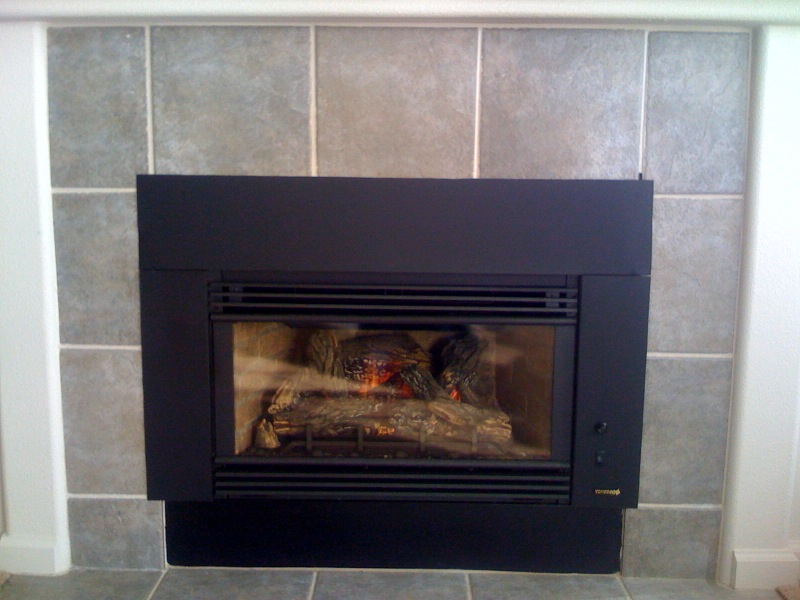Wood burning fireplace insert installation on Custom