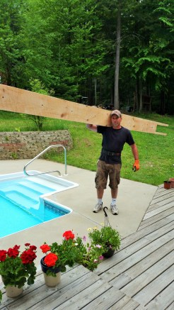 bringing-timber-beam-into-the-house (6)