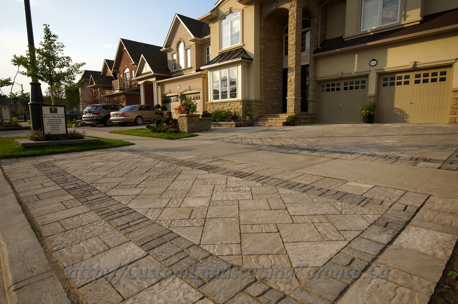 Patio Deck with large interlock and landscaping design