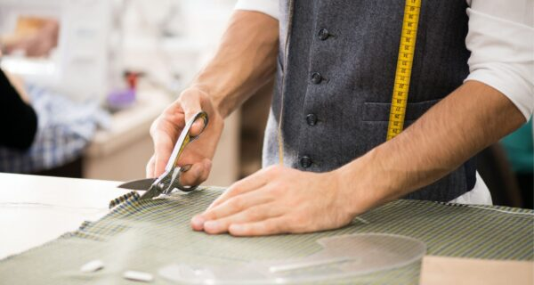 male-tailor-cutting-fabric