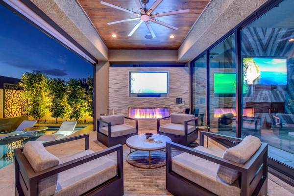 Featured Custom Media Wall With Stacked Stone Finish, Custom Outdoor Fireplace, and Recessed Flat Screen TV