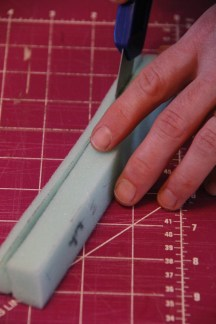 Carefully cutting the high density foam...