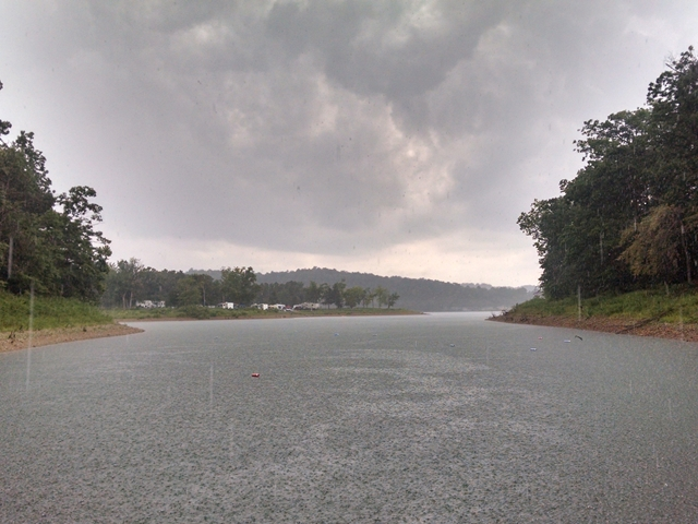 Rain coming in across  Horseshoe Bend Cove Beaver Lake  Arkansas