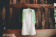 My wedding dress with my cute green cardigan! I bought all of my bridal party a vintage hanger to hang their dresses on.
