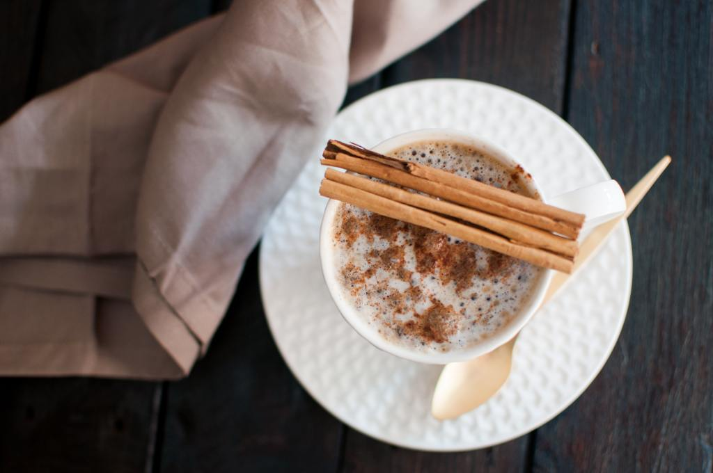 cinnamon sticks over drink
