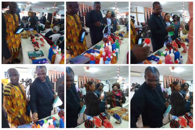 The invited dignitaries inspecting the displayed products...