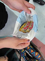 A bag of candy is shown off by a student. Photo by Alison Dhont.