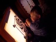 boy, light box, spinnng wheel
