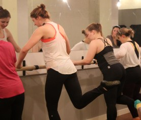 Hanna demonstrates a glute strengthener exercise.