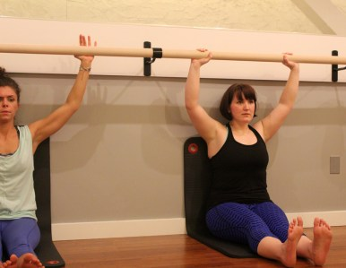 Erin in flat back at the barre.