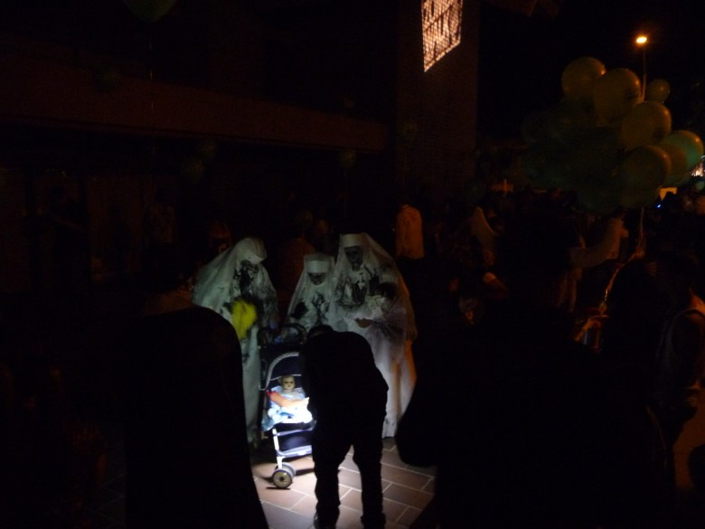 images/Downtown Palm Springs Halloween 2013/zombie-walk-staging-creepiness_10603869855_o