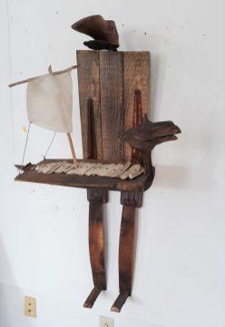 """Janet Van Fleet: Ship; wood, goatskin, antique shoe last, bones; 45x27x16"""""""