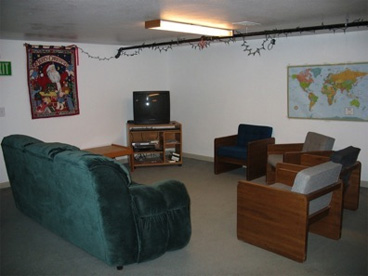 main room with chairs and couch in the basement