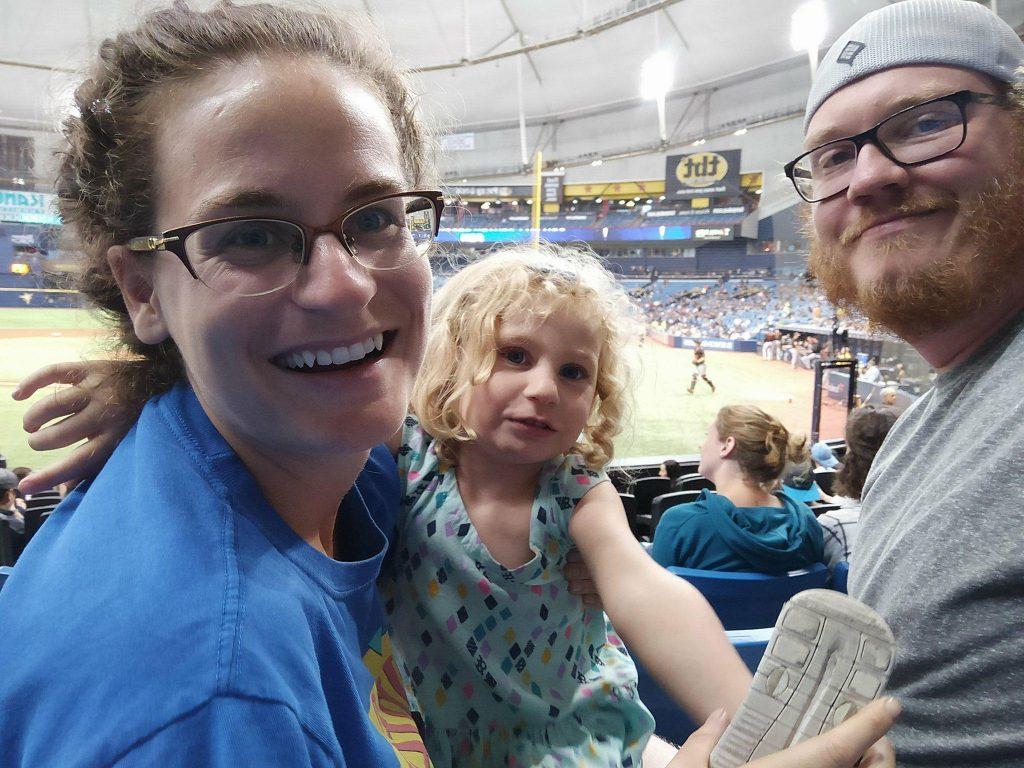 family of 3 at baseball game