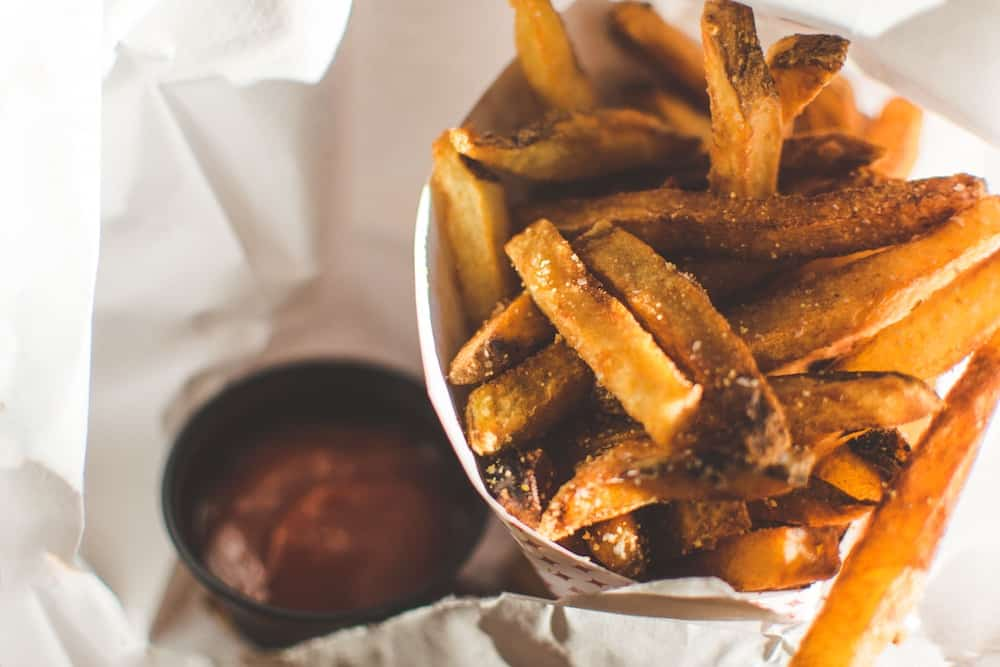 Some fries and ketchup.
