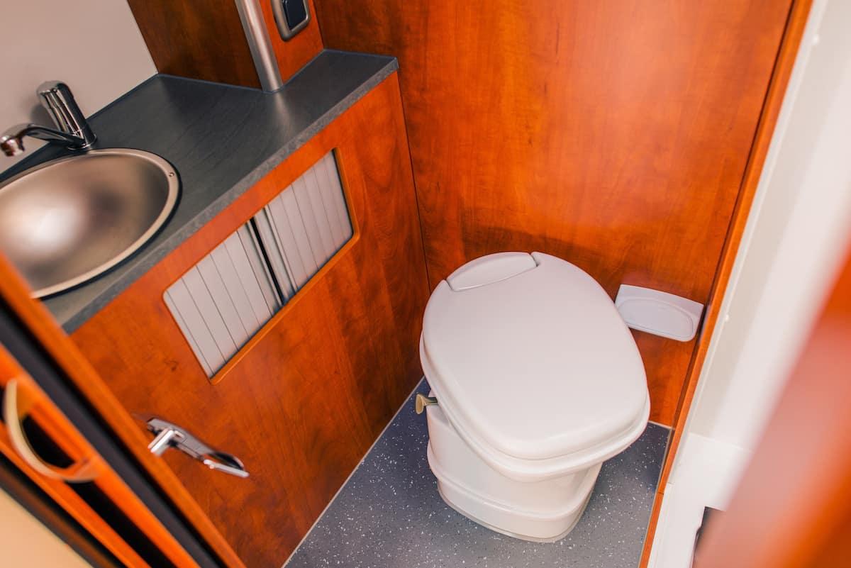 Elegant Camper RV Bathroom with Cassette Toilet. Rving in Style.