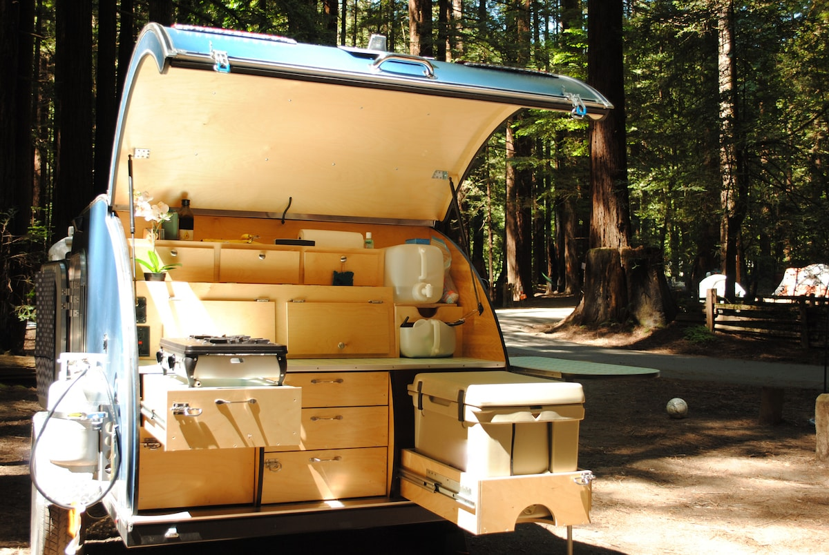 Kitchen of a teardrop trailer at a campsite in Redwood Forest
