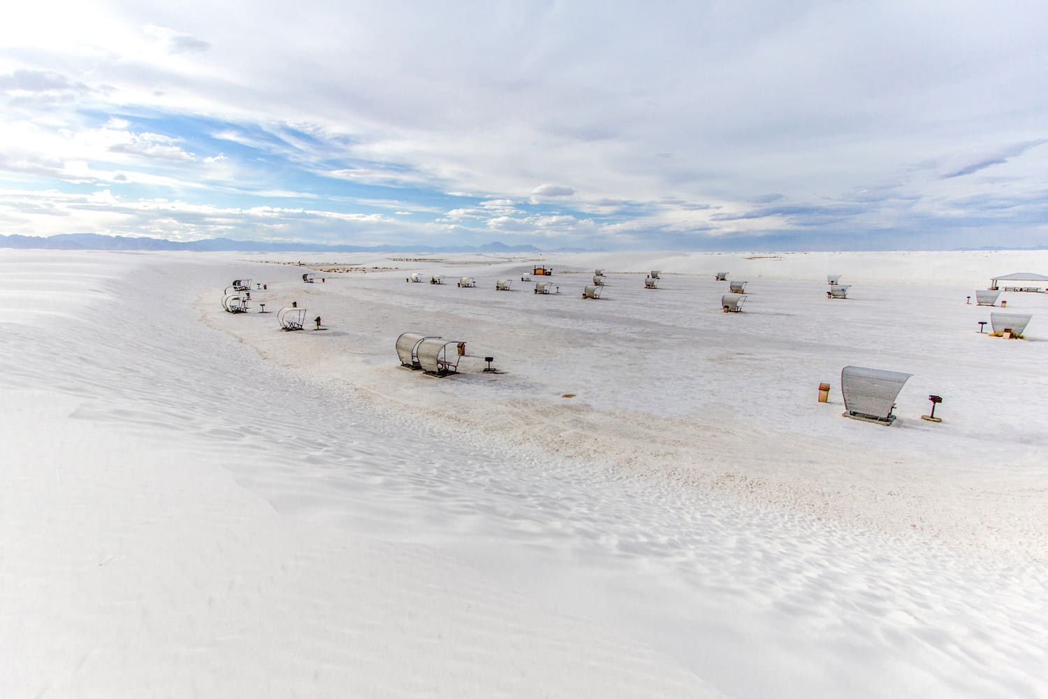 Massive sand dune in the White Sands National Monument in New Mexico surround the National Park picnic area. The National Park features the largest gypsum dune system in the world and is renowned for it's surreal other worldly like landscapes.