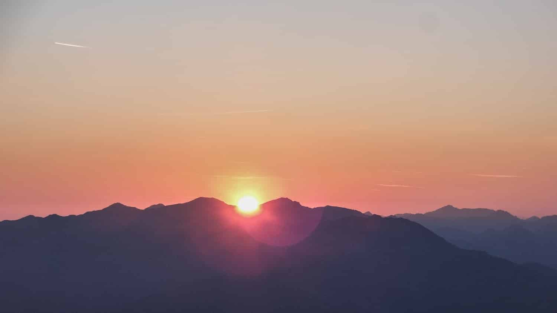 A sunrise over a mountain top