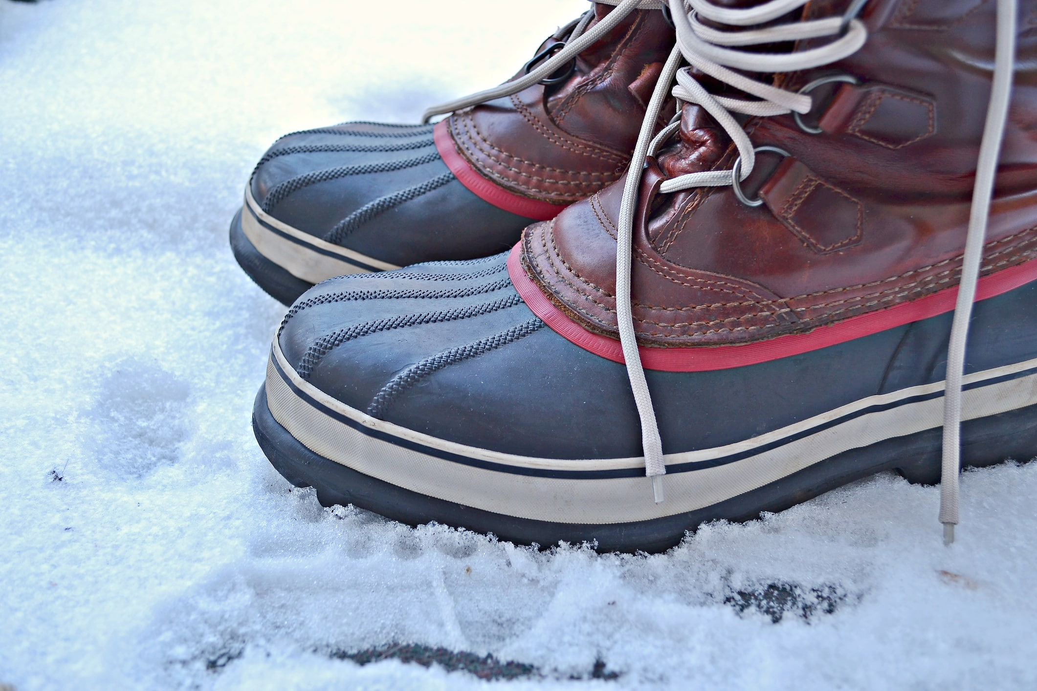 Men's snow boots standing on snow outdoors