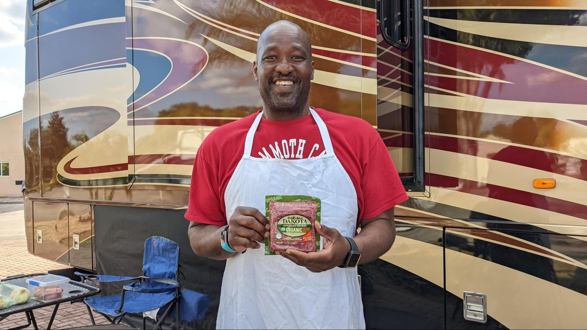 Keith Sims holding organic ground beef