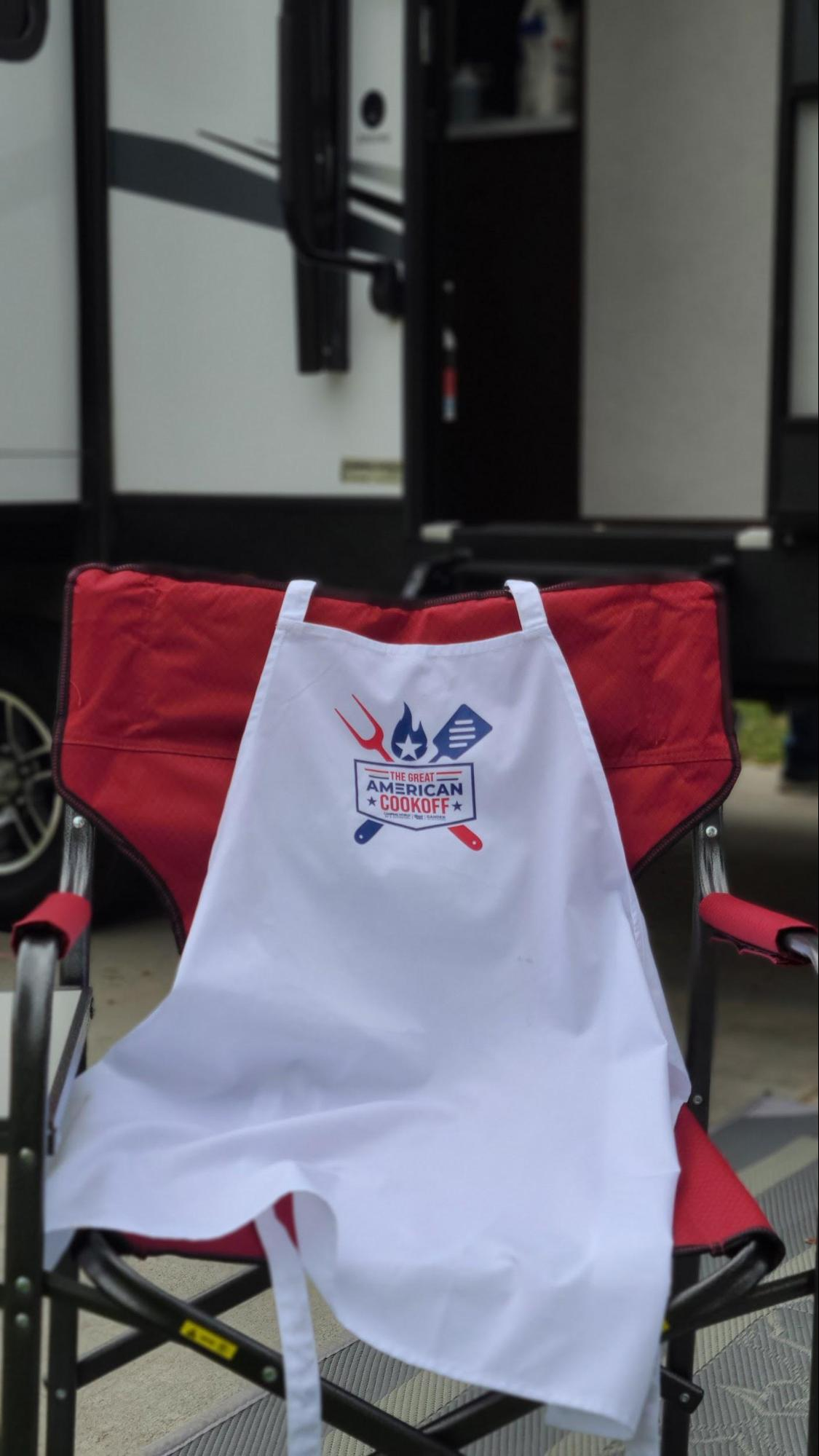 great American cook off apron on chair