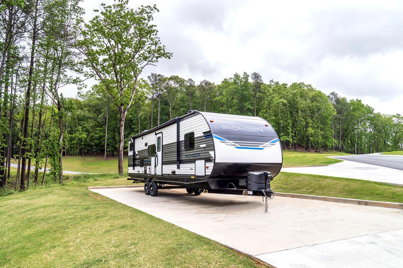 Heartland Pioneer travel trailer at campsite