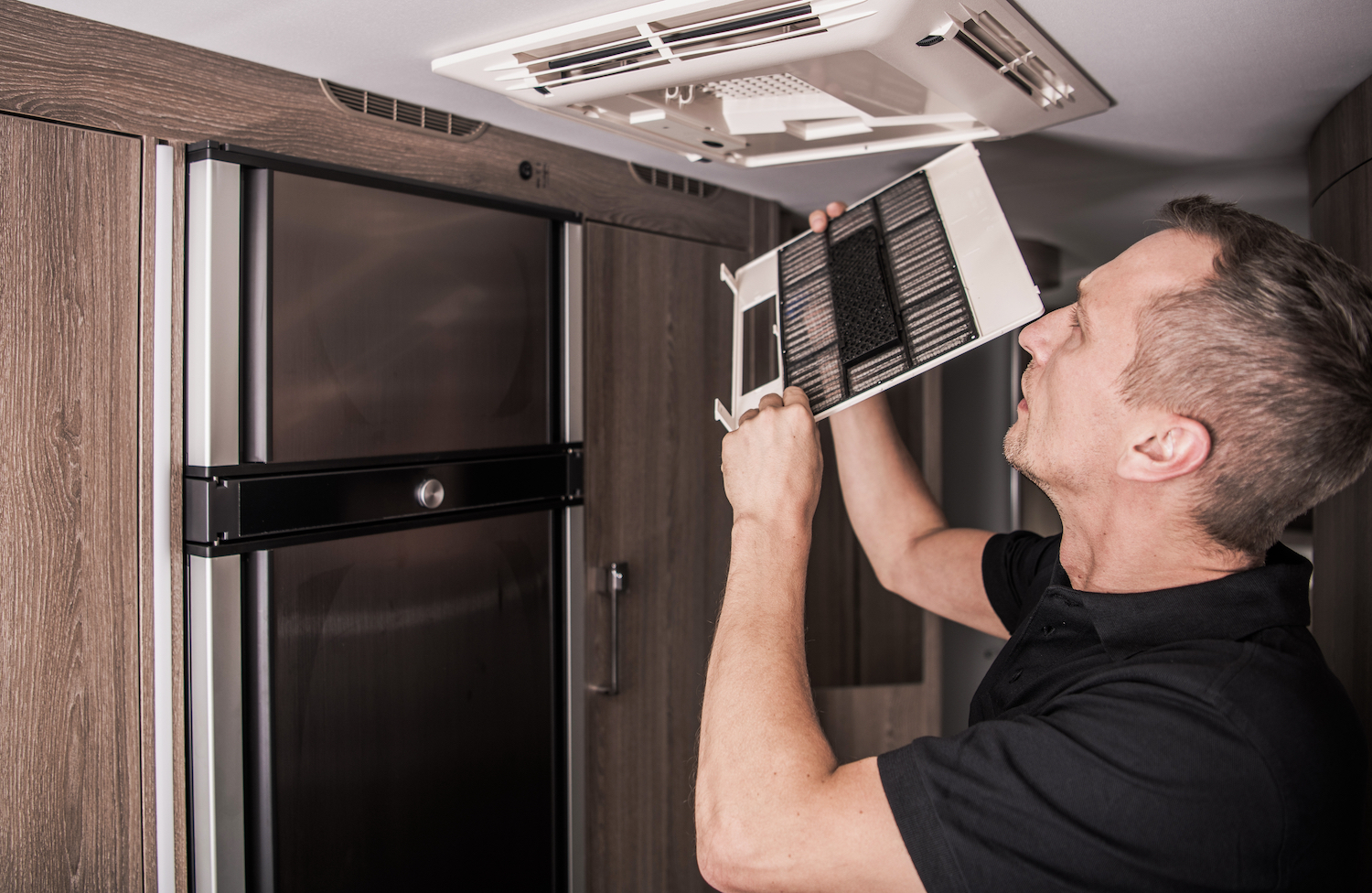 technician cleaning rv vent