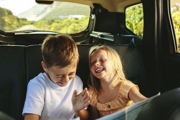 Kids in car on road trip.