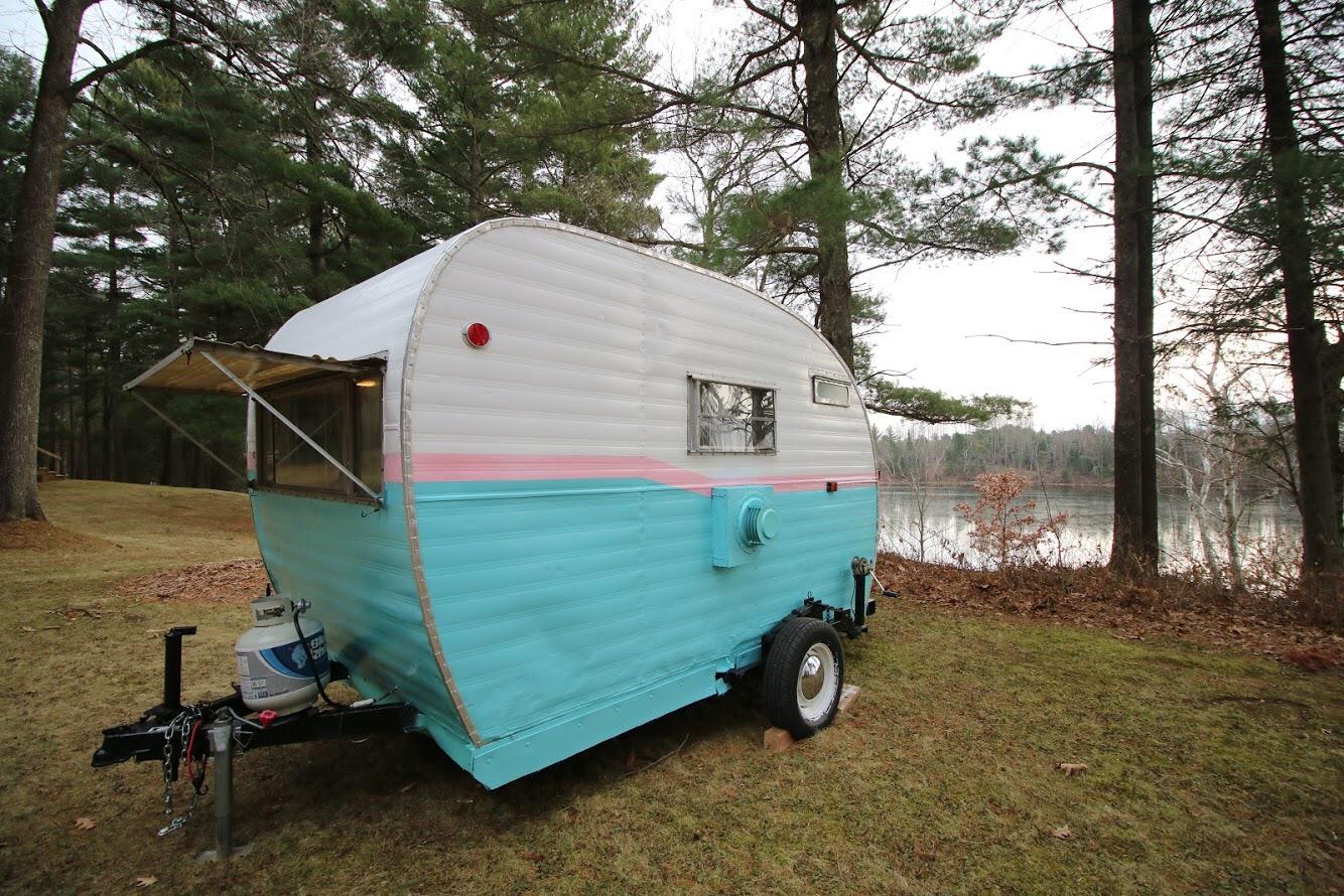 Vintage camper next to lake