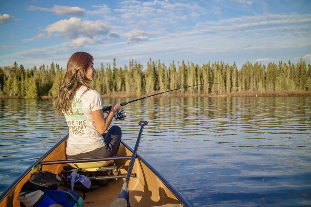 Jenny Anderson canoe fishing on a lake in Superior National Forest