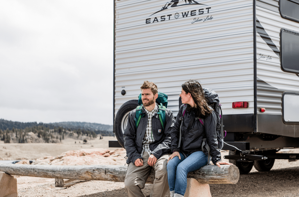 Couple on rear of East to West Silver Lake RV.