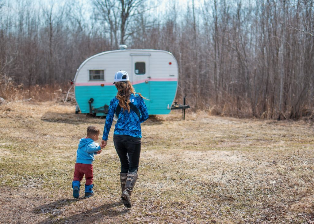 Jenny and family with vintage camper, the Lil Hotdish