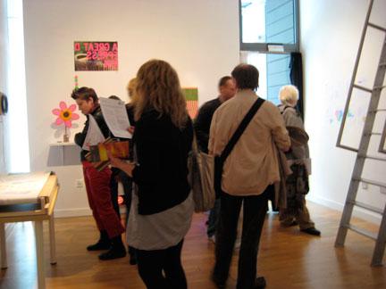 Visitors look at my work in the residency studio/gallery.