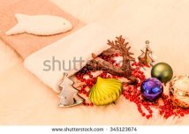 stock-photo-christmas-ornaments-in-stocking-345123674