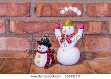 stock-photo-two-snowmen-on-peaceful-christmas-338931377