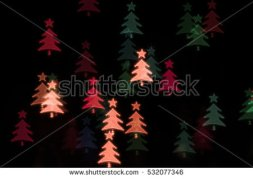 stock-photo-bokeh-flying-christmas-trees-532077346