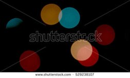 stock-photo-bokeh-flying-circles-529238107
