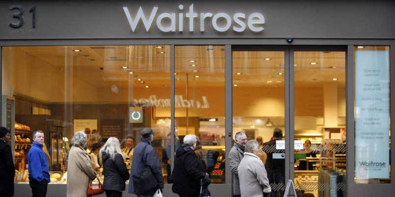Customers queue outside the first Waitrose convenience store, which opened today on Trinity Square in Nottingham.