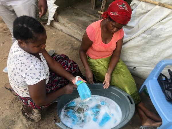 Mozambican Women Caught Washing Used Face Masks
