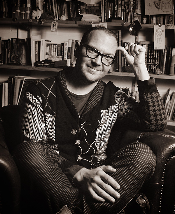 Cory Doctorow (craphound.com) is a science fiction author, activist, journalist and blogger -- the co-editor of Boing Boing (boingboing.net) and the author of young adult novels like PIRATE CINEMA and LITTLE BROTHER and novels for adults like RAPTURE OF THE NERDS and MAKERS. He is the former European director of the Electronic Frontier Foundation and co-founded the UK Open Rights Group. Born in Toronto, Canada, he now lives in London and is pictured here in his office.